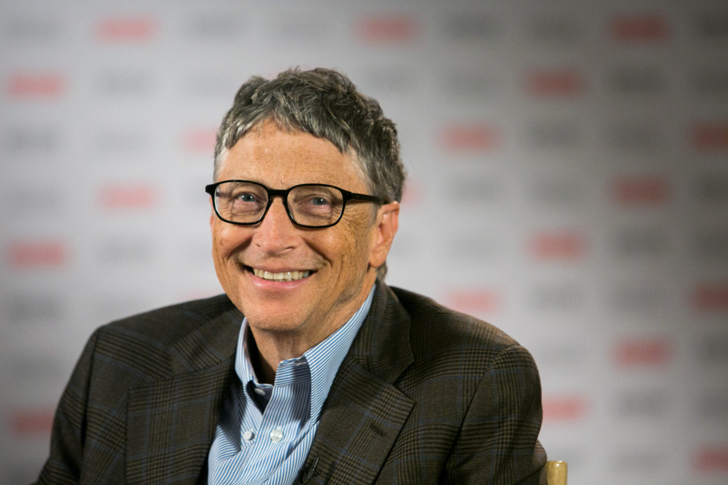 "Billionaire Bill Gates, co-founder of Microsoft and co-chair of the Bill and Melinda Gates Foundation, smiles before an interview with Bloomberg Television at the Sibos financial services conference in Boston, Massachusetts, U.S., on Thursday, Oct. 2, 2014. Gates said he is ""very happy"" with Microsoft chief executive officer Satya Nadella and he is working with the company to improve it's Office software. Photographer: Kelvin Ma/Bloomberg"